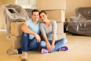 45858911 - portrait of happy couple sitting in new house