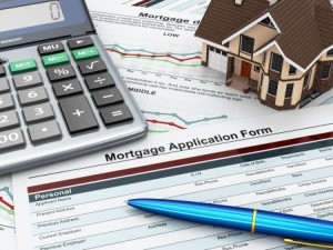 19750953 - mortgage application form with a calculator and house  3d