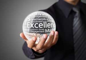 29880491 - businessman hand showing excellence word in crystal ball