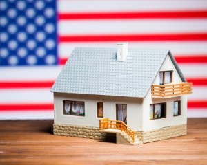 22903134 - usa real estate concept: house against american flag