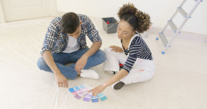 71836378 - couple looking at paint swatches for decorating